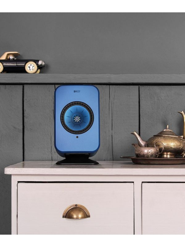 Wireless KEF LSX Speaker stand in black with blue speaker. Dresser top speaker stands.